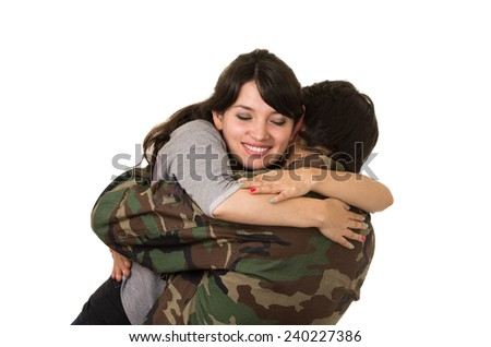 young military soldier returns to meet his happy wife girlfriend hug isolated on white - stock photo