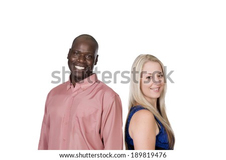 young mixed couple black man and blond caucasian woman standing back to back in studio on a white background  - stock photo