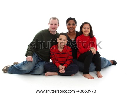 Young mixed race family on a white background - stock photo