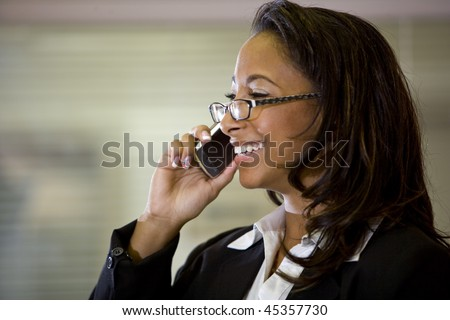 Young mixed-race Hispanic African-American woman talking on mobile phone - stock photo