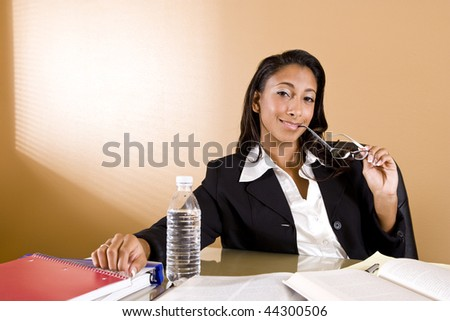 Young mixed-race Hispanic and African-American woman studying - stock photo