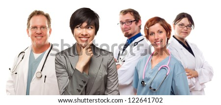 Young Mixed Race Woman with Doctors and Nurses Behind Isolated on a White Background. - stock photo