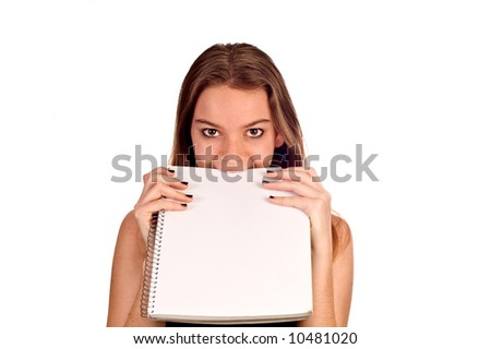 Young model biting a blank pad of paper, isolated against white.