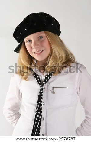 young model girl in fashion hat and tie