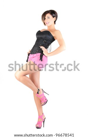 young model in pink mini skirt and black corset posing, full length, isolated - stock photo