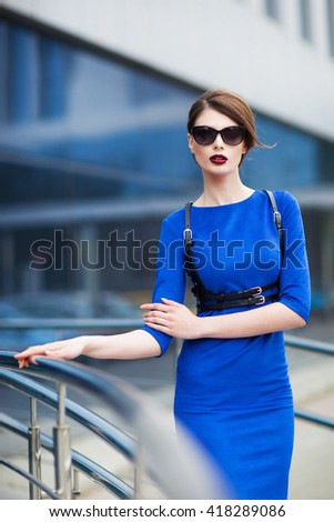 Young model posing in blue dress