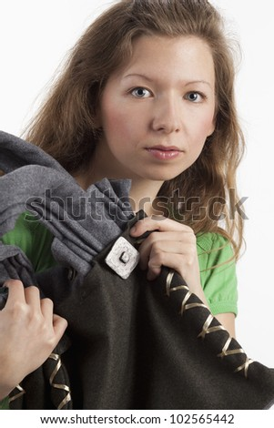 Young model presents bag in traditional style - stock photo