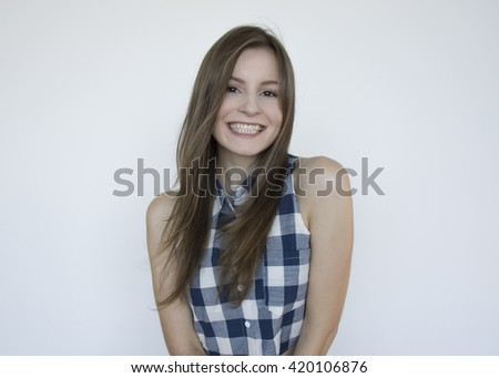 Young model with long hair posing on a white background