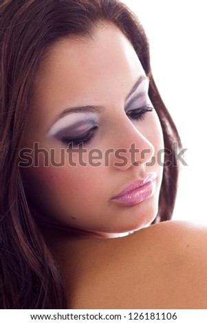 Young model, woman, in a beauty related pose, looking to her shoulder. - stock photo
