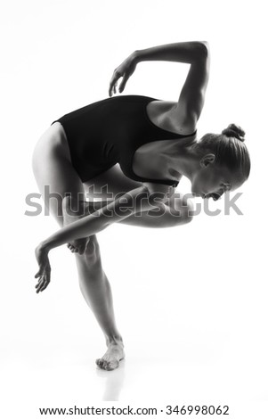 Young modern ballet dancer posing on white background  - stock photo