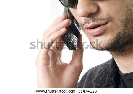 young modern business man talking on cell phone - stock photo