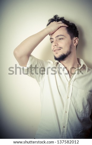 young modern stylish man on vignetting background