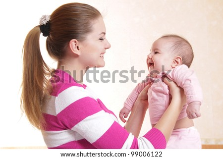 young mother and baby at home - stock photo