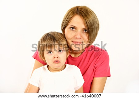 young mother and daughter over white background - stock photo