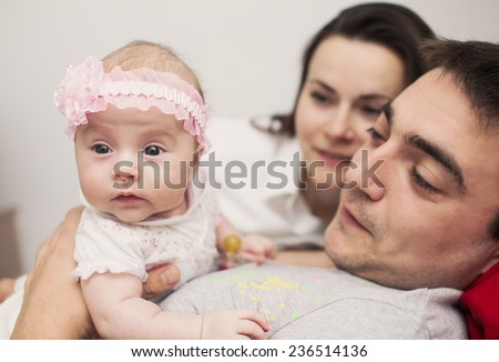 Young mother and father with newborn - stock photo