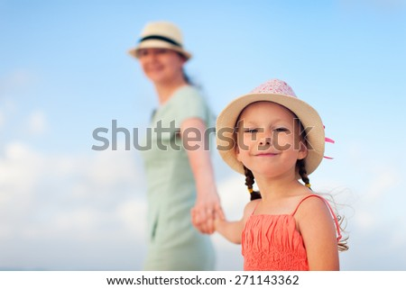 Young mother and her adorable little daughter on summer vacation - stock photo