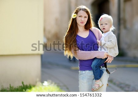 Young mother and her adorable toddler daughter