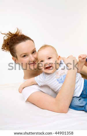 Young mother and her baby girl - stock photo