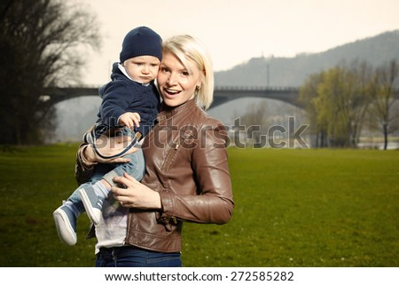 Young mother and her boy - stock photo