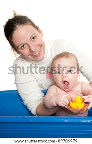 young mother and her cute baby in the bath, isolated on white background - stock photo