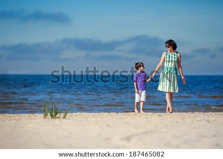 Young mother and her cute little son on summer vacation - stock photo