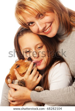 Young mother and her daughter with Jack Russell Terrier. over white background - stock photo