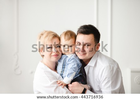 young mother and her husband spend time with his son