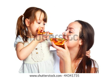 young mother and her little daughter eating pizza and having fun - stock photo