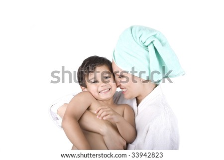 Young mother and her son after taking a bath - stock photo