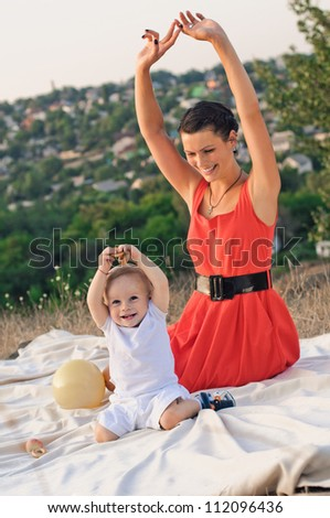 young mother and her son in the outdoor - stock photo