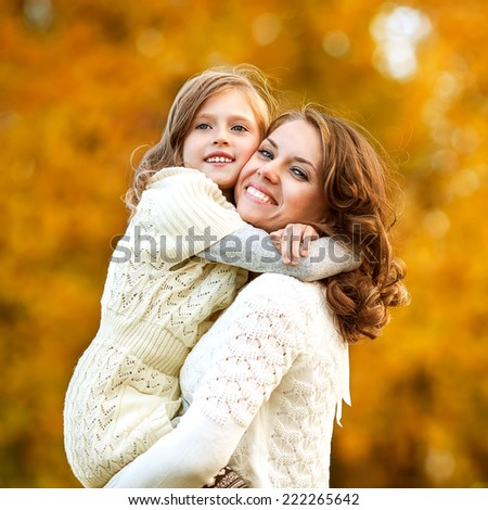 Young mother and her toddler girl have fun, mother's Day. - stock photo