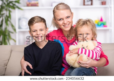 Young mother and her two children. Happy family. - stock photo