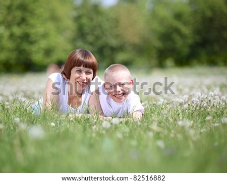 Young mother and her young son in the park