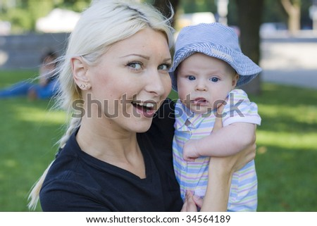 Young mother blonde with baby - stock photo