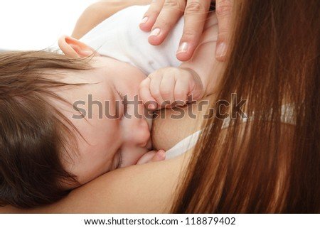young mother breast feeding her infant over white background
