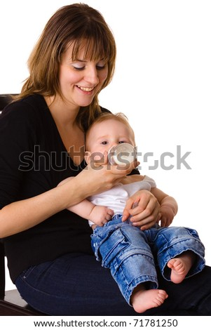 Young mother feeding her baby