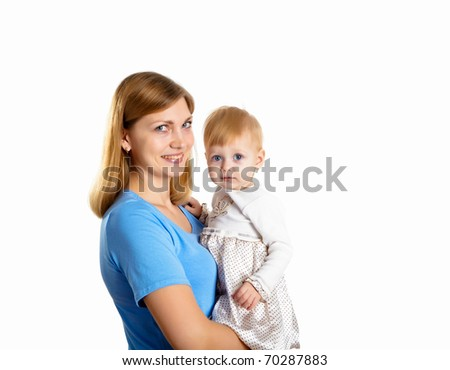 young mother having fun with her little son on the floor