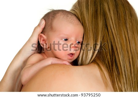 Young mother holding her 18 days old baby - stock photo