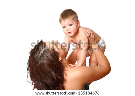 Young mother holding her son in her arms on  white background - stock photo
