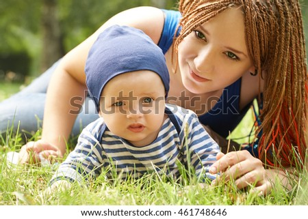 young mother playing with her baby. Mom and son in a park
