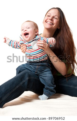 young mother playing with her cute smiling baby, isolated on white background - stock photo