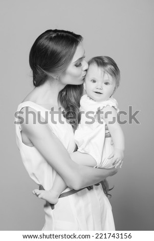 Young mother playing with little baby girl - stock photo
