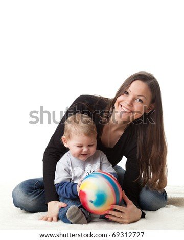 Young mother plays with her baby on a white background. Happy family. - stock photo