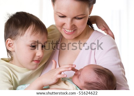 young mother sits with her two children