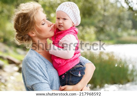 Young mother with adorable daughter