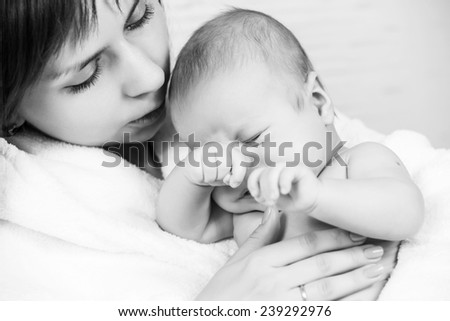 Young mother with adorable newborn baby, child care, happy parenthood, love concept - stock photo