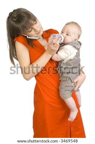 Young mother with baby boy on hand. Feeding baby and talking by mobile phone. Isolated on white - stock photo