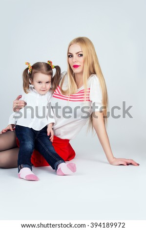 Young mother with baby daughter - stock photo