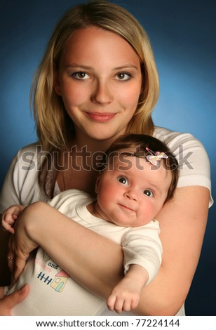 young mother with baby on blue background