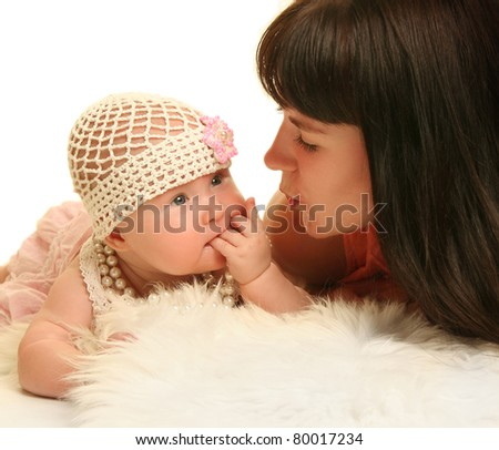 young mother with baby on blue background - stock photo